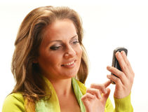 Young woman using smartphone isolated on white Stock Image