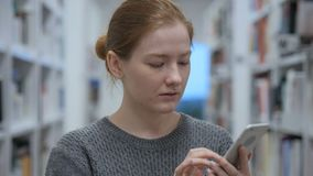 Young Woman Using Smartphone for Online Browsing. 4k , high quality stock video