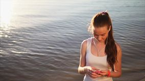 Young woman using smartphone outside. stock footage