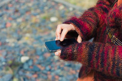 Young woman using smartphone outside Stock Photos