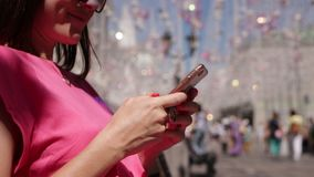 Young woman using smartphone on the street. Female, cellphone, chating. stock footage