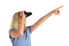 Young woman using spyglass Stock Photos