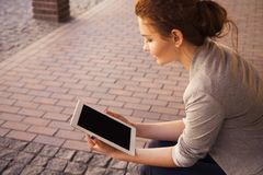 Young woman using a tablet Royalty Free Stock Images
