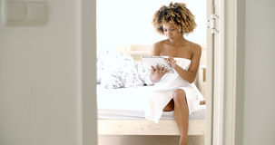 Young Woman Using Tablet On Bed Stock Images