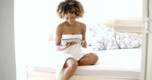 Young Woman Using Tablet On Bed Royalty Free Stock Photo