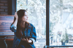 Young woman using tablet in coffee shop. Hipster girl in cafe. Real time shot in light nature Royalty Free Stock Photos
