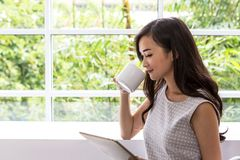Young woman using tablet in coffee shop. Woman use mobile phone at coffee shop. stock images