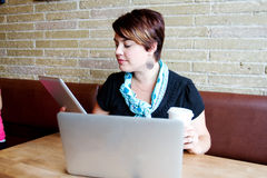 Young woman using tablet and computer Stock Images