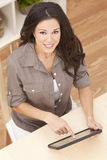 Young Woman Using Tablet Computer at Home Stock Images