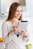 Young woman using a tablet computer at home Stock Image
