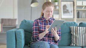 Young woman using tablet computer for internet stock video