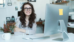 Young woman using tablet computer at office or school. look at camera stock footage