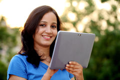 Young woman using tablet computer at outdoor Royalty Free Stock Photo