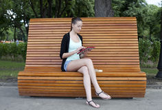 Young woman using a tablet computer on a park Royalty Free Stock Photo