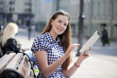Young woman using a tablet computer Royalty Free Stock Image