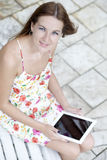 Young woman using a tablet computer Royalty Free Stock Photo