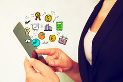 Young woman using tablet device and set of business sketches. Royalty Free Stock Image