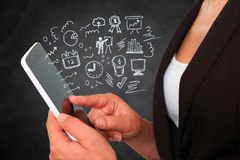 Young woman using tablet device and set of business sketches