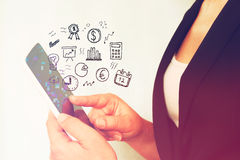 Young woman using tablet device and set of business sketches. Royalty Free Stock Images