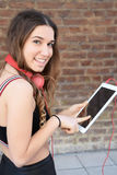 Young woman using a tablet. Royalty Free Stock Photo