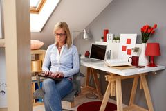 Young woman using tablet at home Royalty Free Stock Photo