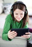 Young woman using tablet Stock Photography