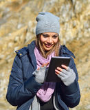 Young woman using tablet outdoor Royalty Free Stock Photo