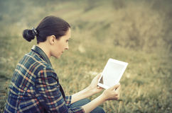 Young woman using tablet outdoor Stock Photo
