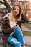 Young woman using tablet outdoor smiling Stock Photo