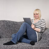 Young woman using tablet pc Stock Image