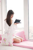 Young woman using tablet PC Stock Photo