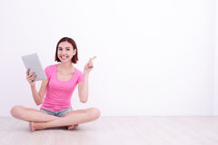 Young woman using tablet pc Stock Photos