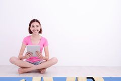 Young woman using tablet pc Stock Images