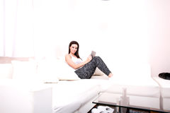 Young woman using a Tablet PC on the Sofa Royalty Free Stock Images