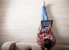Young woman using tablet. Royalty Free Stock Photography