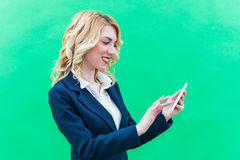 Young woman using tablet, standing. Royalty Free Stock Photography