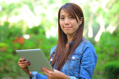 Young woman using tablet touch computer Stock Image