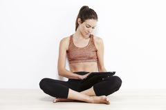 Young woman using a tablet after workout Royalty Free Stock Image