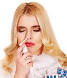 Young woman using throat spray. Stock Images