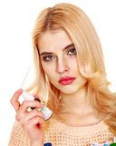 Young woman using throat spray. Isolated Royalty Free Stock Photography