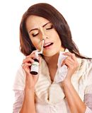 Young woman using throat spray. Stock Image