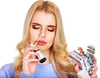 Young woman using throat spray. Isolated Royalty Free Stock Image