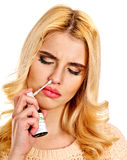 Young woman using throat spray. Royalty Free Stock Image