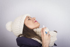 Young woman using throat spray. Stock Photos