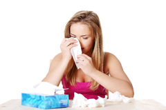 Young woman using a tissue. Royalty Free Stock Photo