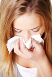 Young woman using a tissue. Stock Photo