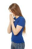 Young woman using a tissue. Royalty Free Stock Images