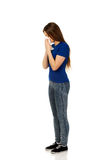 Young woman using a tissue. Royalty Free Stock Image