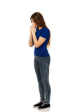 Young woman using a tissue. Royalty Free Stock Photos