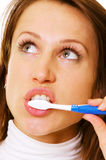 Young woman using toothbrush Stock Photo